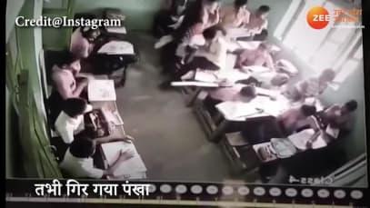 Horrifying: Fan falls down while children study